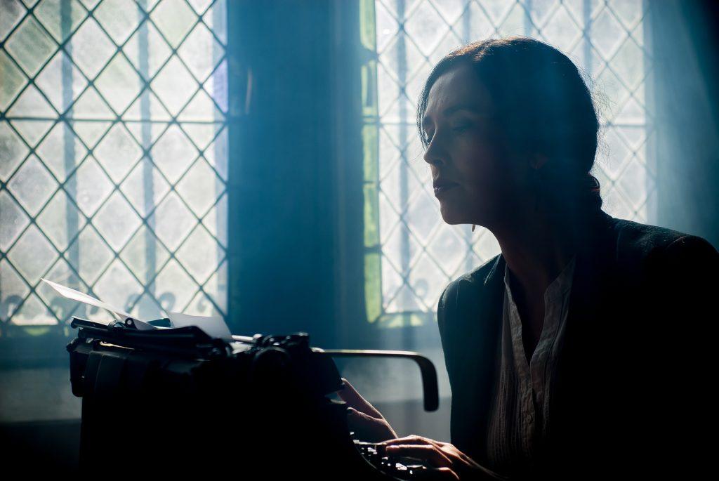 Woman sitting at typewriter